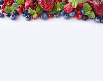 Black-blue and red fruits. Ripe red currants, strawberries, raspberries, blueberries and blackcurrants on white background. Berries with copy space for text. Background berries.