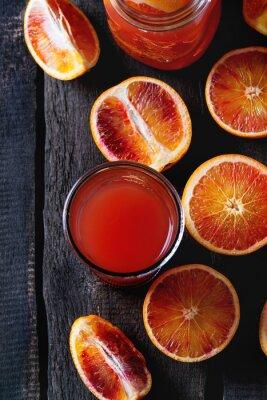 Canvas print Blood oranges with juice