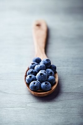 Canvas print Blueberries on  a wooden spoon