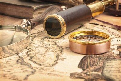 Canvas print Brass telescope on map