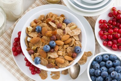 Canvas print breakfast with cereals flakes, nuts and berries, top view