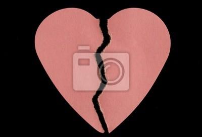 Canvas print broken paper heart on a black background