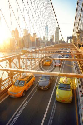 Brooklyn Bridge with traffic at sunset