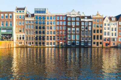 Canvas print Buildings along the Damrak during the day in Amsterdam