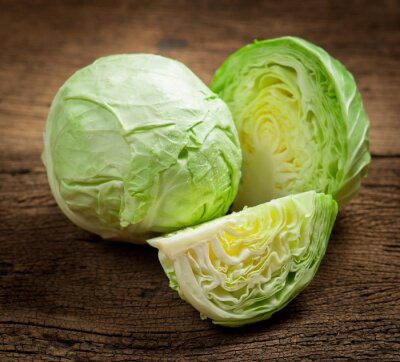 Canvas print cabbage and cutted cabbage on wooden