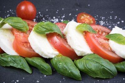 Canvas print Caprese salad on dark slate background