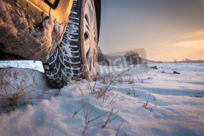 Canvas print Car tires on winter road