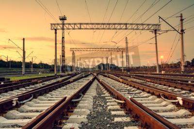 Canvas print Cargo train platform at sunset. Railroad in Donetsk. Railway station