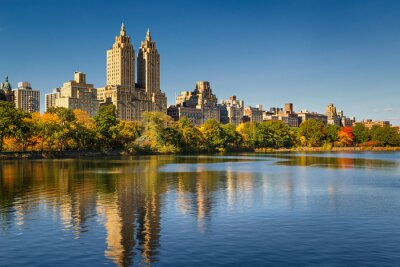 Canvas print Central Park and Manhattan, Upper West Side with colorful Fall foliage. A clear blue sky and buildings of Central Park West reflecting in the Jacqueline Kennedy Onassis Reservoir. New York City.