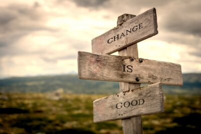 Canvas print Change is good quote on wooden signpost in nature with moody background. Motivational, move on, changes, choice, choices concept.