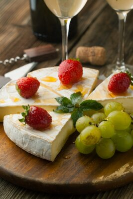 Canvas print Cheese with strawberries and honey