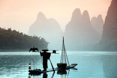 Canvas print Chinese man fishing with cormorants birds