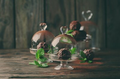Canvas print Chocolate sweets with nuts, mint and cacao on the vintage table