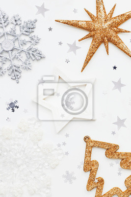 Christmas and New Year background with sparkling fir tree, snowflakes and star confetti. Holiday symbols on white background with place for text.