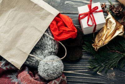 christmas shopping concept. big sale. seasonal rustic background with bags of buyed clothes presents. advertising with space for text