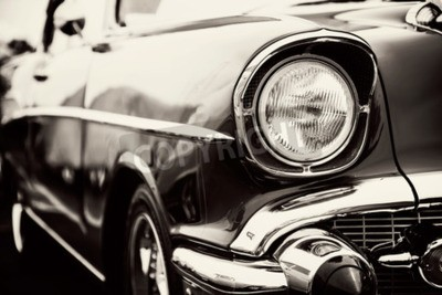 Canvas print Classic car with close-up on headlights