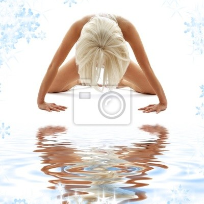 classical artistic nudity style picture of woman on white sand