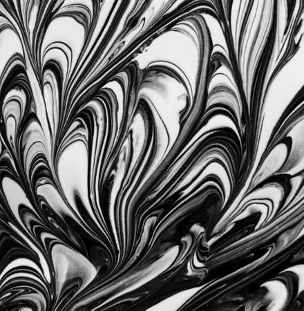 close up of black and white oil paint