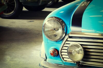 Canvas print Close Up of Front of a Soft Green Vintage Car