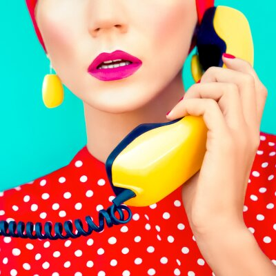 Canvas print close-up portrait of a retro girl with telephone