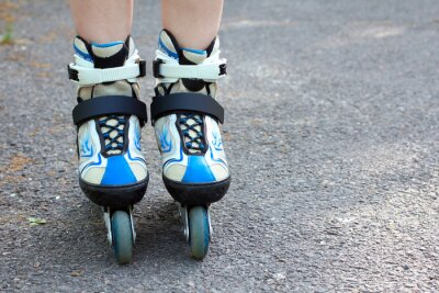 Canvas print Close-up view on teenager holding roller skate