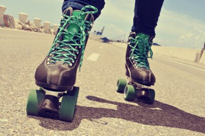 Canvas print closeup of a young man roller skating, with a cross-processed ef
