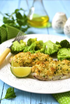 Canvas print Cod baked with garlic bread crumbs.