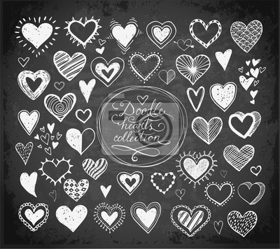 Collection of doodle sketch hearts hand drawn with ink isolated on blackboard background. Vector illustration.