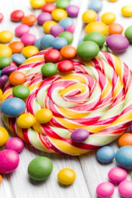 Canvas print colored candy and lollipop
