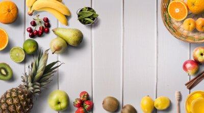 Colorful Fresh fruit on white wood table. Orange, strawberries, lemons, banana, pineapple, limes, pears, kiwi, apple. Summer fruit. Flat lay, top view. fruits and vegetables