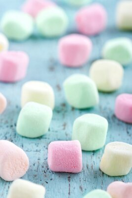 Canvas print Colorful small marshmallows on wooden background