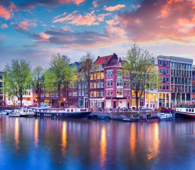 Canvas print Colorful spring sunset on the canals of Amsterdam