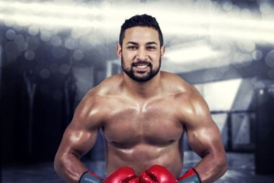 Canvas print Composite image of muscular man boxing in gloves
