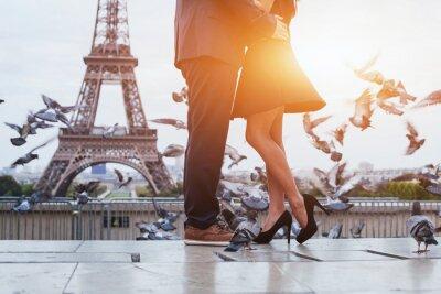 Canvas print couple near Eiffel tower in Paris, romantic kiss