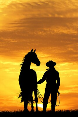 Canvas print cowboy with horse at sunset