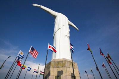 Canvas print Cristo del Rey statue of Cali with world flags and blue sky, Col