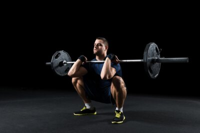 Canvas print Crossfit athlete performs  weight lift