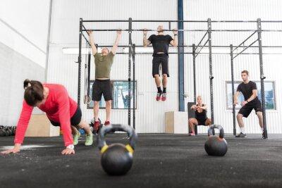 Canvas print Crossfit group trains different exercises
