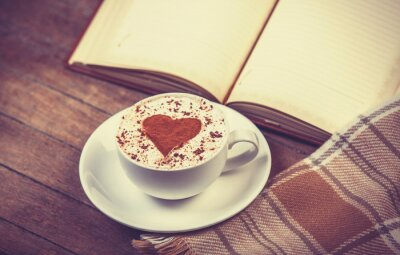 Canvas print Cup of coffee and book with scarf