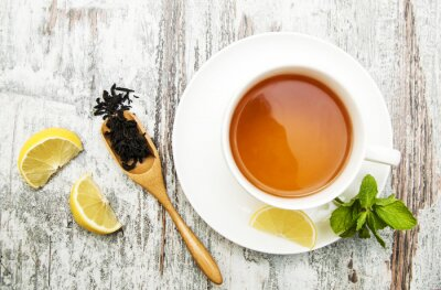 Canvas print Cup of tea with lemon and mint