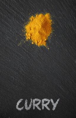 Canvas print Curry on a black slate table