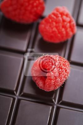 Canvas print dark chocolate bar with raspberry