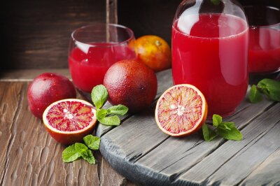 Canvas print Delicious juice with red oranges and mint