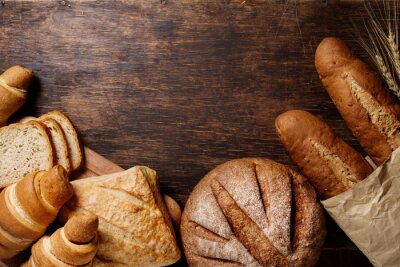 Canvas print Different bread on a rustic dark background
