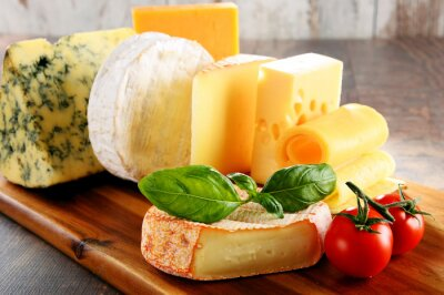 Canvas print Different sorts of cheese on kitchen table