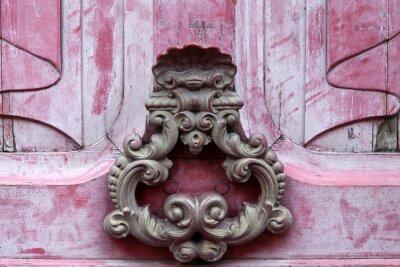 Canvas print Door knoker on an old pink  wodden door