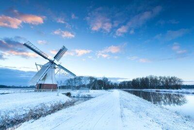 Canvas print Dutch windmill in snow winter