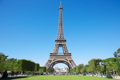 Canvas print Eiffel tower, sunny summer day with blue sky and green Field of Mars