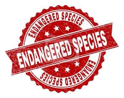 Canvas print ENDANGERED SPECIES seal print with corroded texture. Rubber seal imitation has circle medallion shape and contains ribbon. Red vector rubber print of ENDANGERED SPECIES caption with grunge texture.