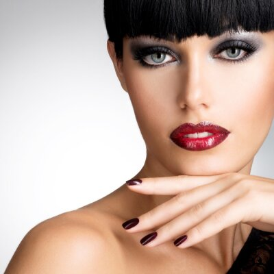 Canvas print Face of a woman with beautiful dark nails and sexy red lips